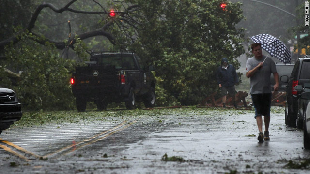 A downed tree cover a street in Brooklyn, New York, on Sunday.