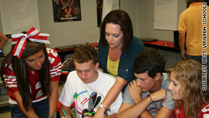 Poca High School teacher Sonjia Richardson, center, works with her students.