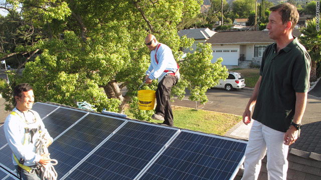 California homeowner Jim Adams, right, installed solar panels on his roof -- saving $10,000 thanks to tax incentives.