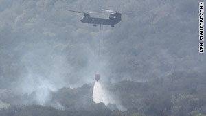 A helicopter helps fight a fire around Possum Kingdom Lake in Palo Pinto County, Texas, on Thursday.