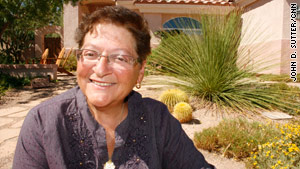 Karen Luksich won a recent contest for water-efficient lawns. Hers is full of low-water desert plants and rocks.