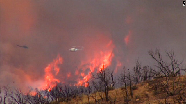 The fire started when a small plane crashed southeast of Tehachapi, California, on Sunday.