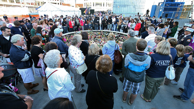 Mourners gather around a reflecting pool in New York in 2010 on the ninth anniversary of the 9/11 attacks.