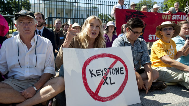 Actress Daryl Hannah, center, sits in front of the White House on August 30 during a protest against the Keystone XL pipeline.