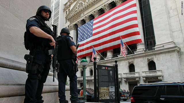 Police officers stand guard outside the New York Stock Exchange as an extra precaution on Friday, September 9.