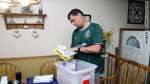"Jim Halloran keeps a box filled with newspaper clippings honoring his brother, fire Lt. Vincent ""Vinny"" Halloran."