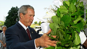 Former President George W. Bush lays a wreath to honor those killed in the terrorist attack on the Pentagon.