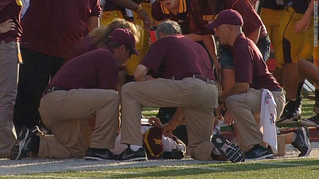 Medical personnel attend to University of Minnesota head football coach Jerry Kill on the sidelines Saturday.