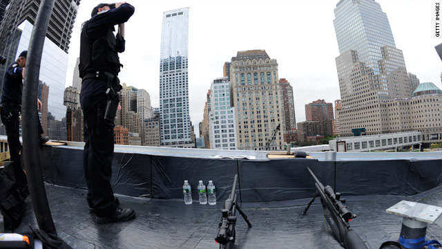 Security officers scan the area near the World Trade Center site during the 10th anniversary of the 9/11 terrorist attacks.