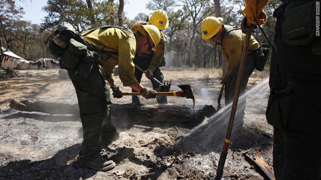 A firefighting crew from California clean up hot spots over the weekend in Bastrop, Texas, after the devastating wildfire.