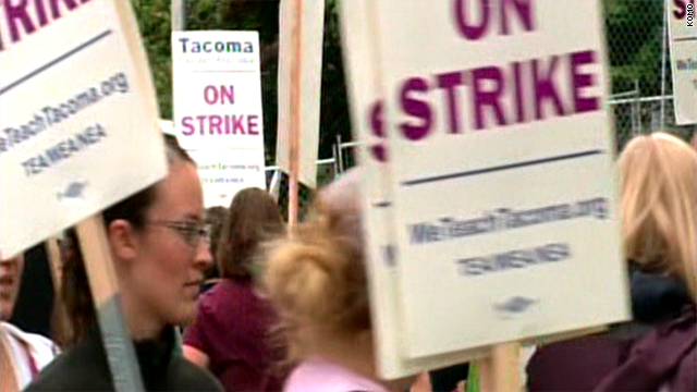 Striking teachers march on a picket line Wednesday in Tacoma, Washington.