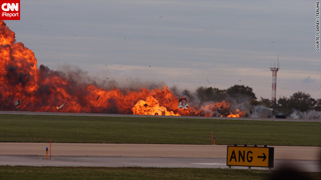 A plane crashes at a West Virginia air show, killing the pilot, but it did not injure anyone on the ground.
