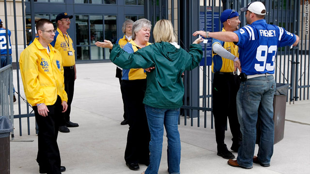 Fans in Indianapolis are searched on Sunday before entering the stadium for the Colts' game against the Cleveland Browns.
