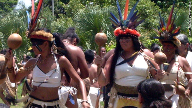 Ana Mara Tekina-eir Maynard, right, dances at the 2010 Tano Day ceremony in Puerto Rico.