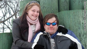 Brittany Noffke, pictured today with her boyfriend, David, wants better safety standards for young athletes.