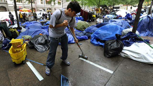 An Occupy Wall Street participant on Thursday helps clean the New York park where protesters have been camping out.