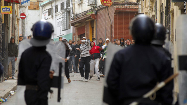 Protestors clash with riot police on January 7, 2011 in central Oran, 430 kilometres (270 miles) west of Algiers.