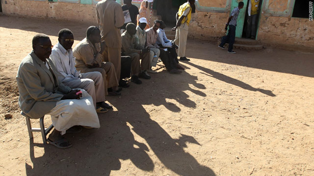 Southern Sudanese voters queue outside a polling station in Khartoum in northern Sudan on Sunday.
