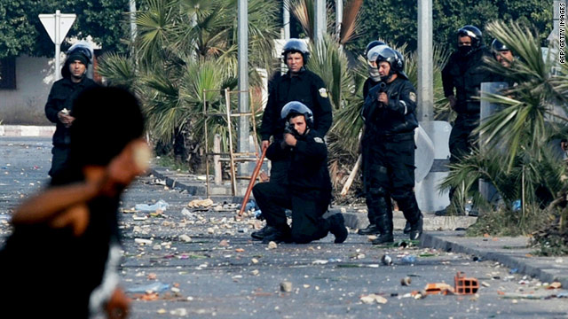 A member of the Tunisian security forces takes aim at a demonstrator on Monday in Regueb.