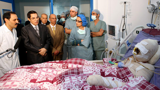 Former Tunisian President Zine El-Abidine Ben Ali (second left) visits Mohamed Al Bouazzizi (right) at the hospital in Ben Arous near Tunis on December 28, 2010. Source: Handout from Tunisian Presidency of Zine El-Abidine Ben Ali.