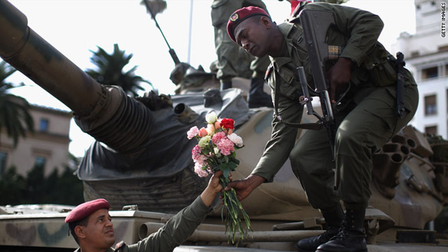 Soldier arrange flowers on their tank as an uneasy peace hangs over Tunisia on January 21. Tunisians have begun three days of mourning in respect of the people who died during the 'Jasmine Revolution.'
