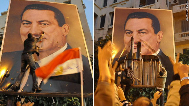 Egyptian demonstrators in Alexandria tear a portrait of President Hosni Mubarak during a protest against his rule Thursday.