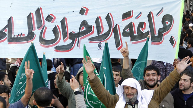 Members of the Muslim Brotherhood movement shout slogans in Amman, Jordan on Friday after weekly prayers.
