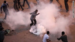 Tear gas surrounds protesters in Egypt. In Egypt and Tunisia, pictures of U.S.-made canisters have been posted online.