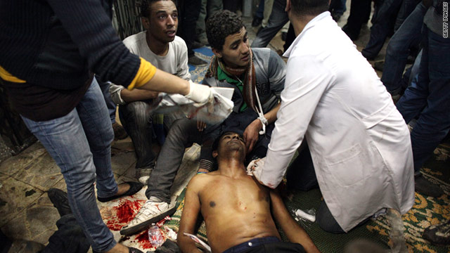 Medics in a mosque attend to a man injured Saturday during clashes with police in Cairo, Egypt.