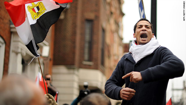 Demonstrators call for the resignation of Egyptian President Hosni Mubarak outside the Egyptian Embassy in London on Saturday.