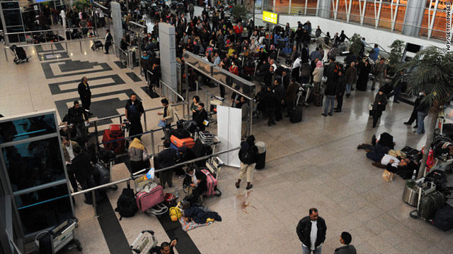 People trying to get flights out of Egypt crowd Cairo International Airport on Sunday.