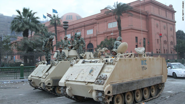 Egyptian soldiers stand guard in front of the National Museum in central Cairo after vandals ripped the heads off two mummies.