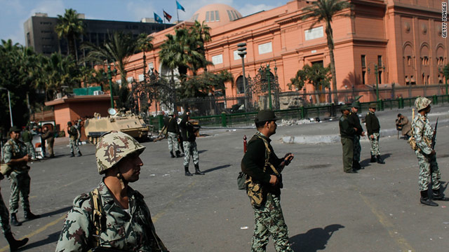 Army soldiers stand guard outside the Egyptian Museum in Cairo's Tahrir Square on Monday, January 31.