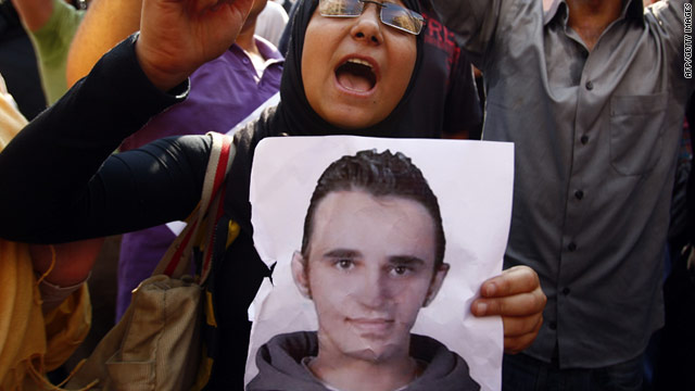 A protester carries a poster of Khaled Said, whose torture and killing by Egyptian police prompted demonstrations in 2010.
