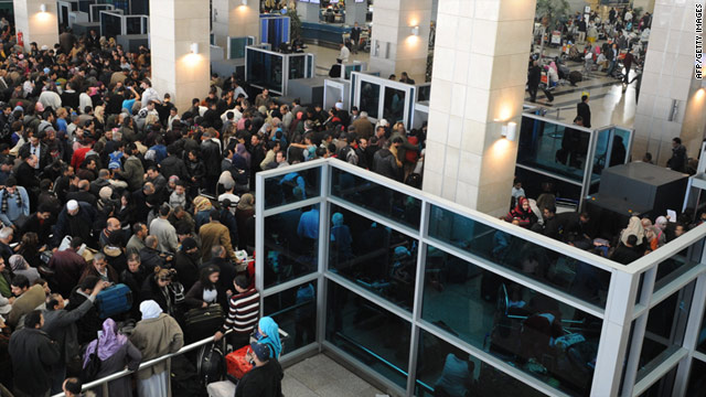 People pack Cairo International Airport this week in an effort to evacuate Egypt.