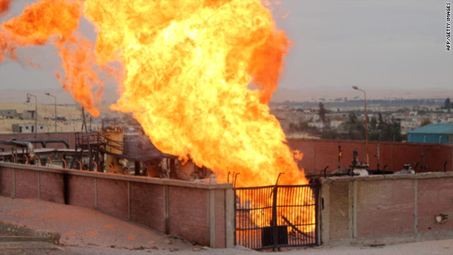 Flames rise from a gas pipeline attack in the Egyptian Sinai town of El Arish on February 5, 2011.