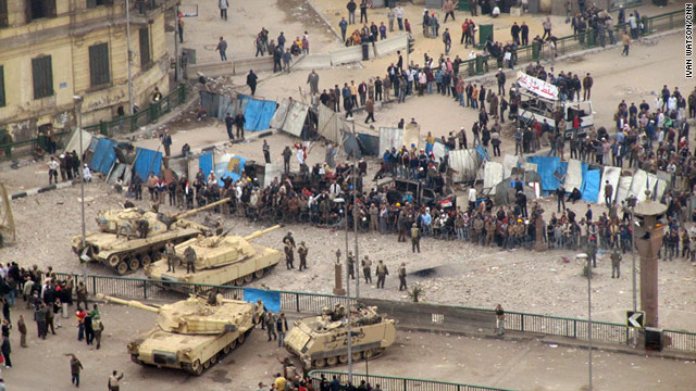 Protesters line up against Egyptian military tanks at an entrance to Tahrir Square on Saturday.