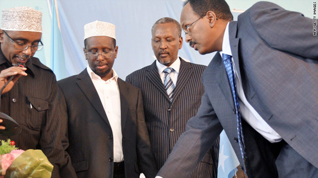 Mohamed Abdulahi Mohamed (right) is sworn in as Somalia's new prime minister in Mogadishu on November 1, 2010.