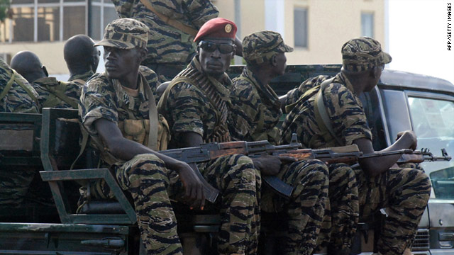 Southern Sudanese soldiers wait for UN envoys at the southern Sudanese capital Juba on October 6, 2010.