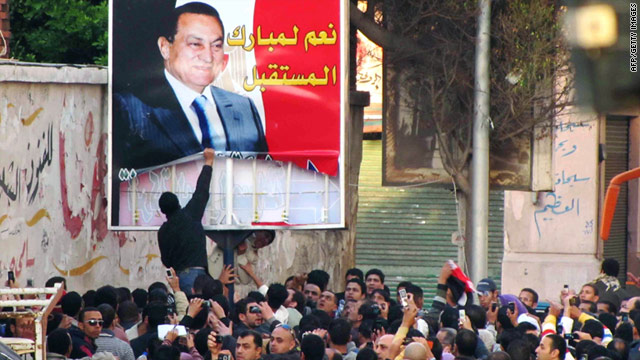 Egyptian protesters tear down a poster of President Mubarak in Alexandria on January 25.