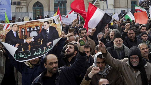 Iranian men rallying Feb. 4 in Tehran in support of Egyptian protests hold up a picture of Presidents Mubarak and Obama meeting.