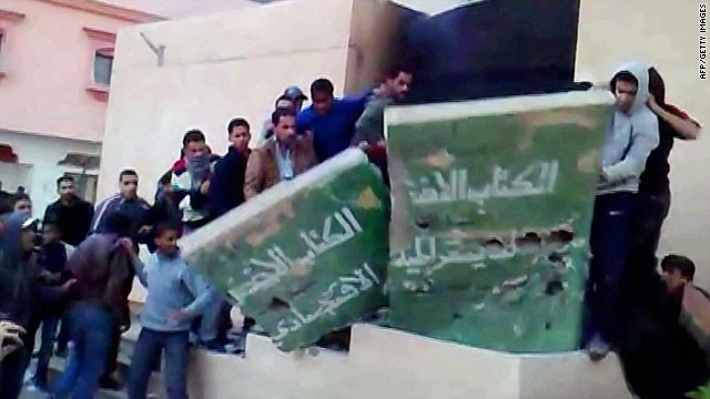 A still from an undated video released February 17, 2011 via YouTube allegedly shows protesters destroying a monument of Libyan leader Moammar Gadhafi's Green book.
