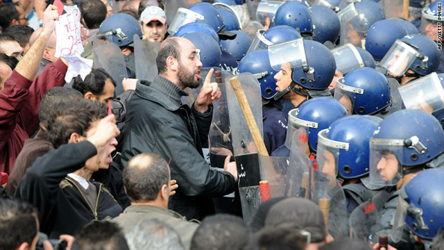 A man gesture towards Algerian police surrounding demonstrators Saturday in Algiers.