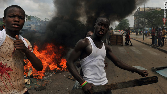 Supporters of Alassane Ouattara burn tyres in protest in Abobo neighborhood in Abidjan, February 19, 2011.