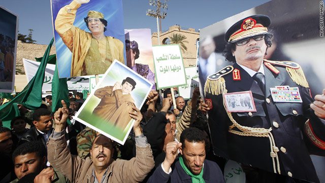 Supporters of Libyan leader Moammar Gadhafi take part in a pro-government rally in Tripoli on Thursday February 17.
