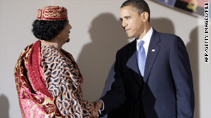 Libyan leader Moammar Gadhafi, left, and President Obama meet at the G-8 summit in Italy in 2009.
