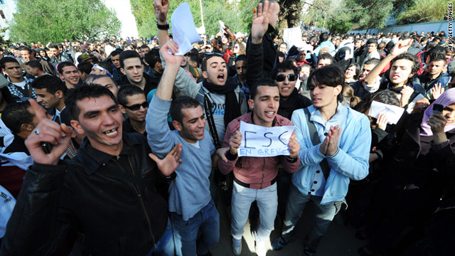 Student protesters shout during a demonstration in Algiers on February 22, 2011.