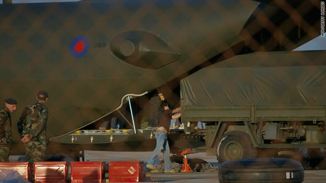 Officials unload supplies from a RAF Hercules in Malta. British and German military planes have rescued hundreds of civilians in remote sites in Libya.