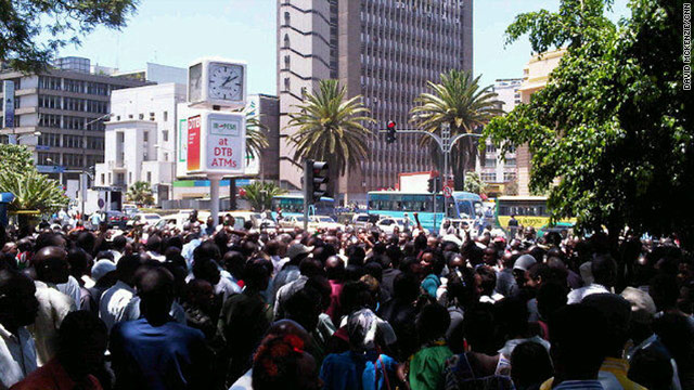 Kenyans gather near an intersection in Nairobi to sing the national anthem in unison, joining Kenyans worldwide calling for unity.