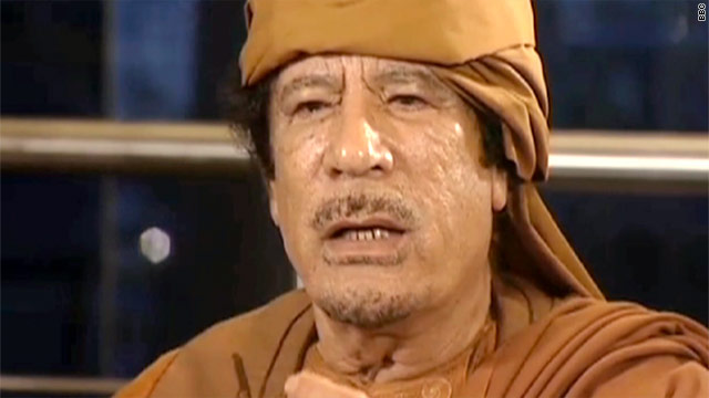 Libyan leader Moammar Gadhafi tells the BBC and ABC News that he blames al Qaeda for holding the city of Benghazi.